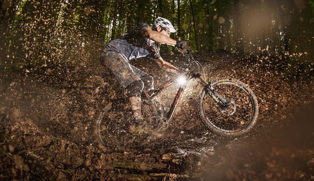 RIDING THROUGH MUD ON MOUNTAIN BIKE